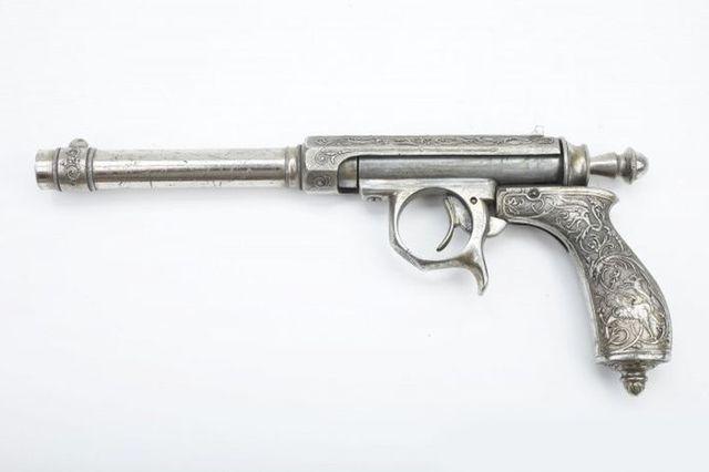 Цельнометаллический пистолет - 45 калибр.