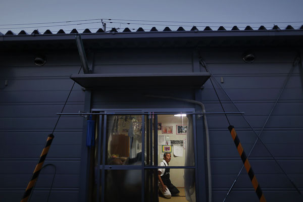 Hiroshi Maskura from the town of Tomioka near the tsunami-crippled Daiichi nuclear power plant sits inside his pre-fabricated house at the center for evacuees where he lives in Iwaki n Fukushima prefecture