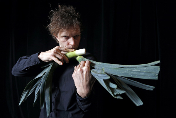 Autrian Musician Meinharte, member of the Vegetable Orchestra, poses for a picture with a musical instrument made out vegetables in Haguenau