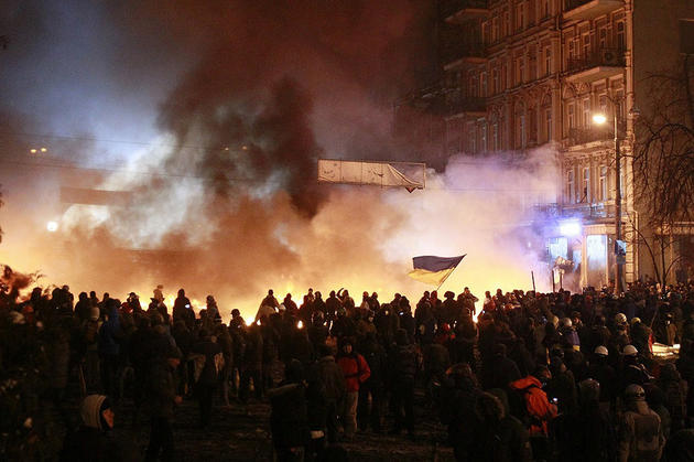 Pro-European protesters burn tyres during clashes with riot police in Kiev