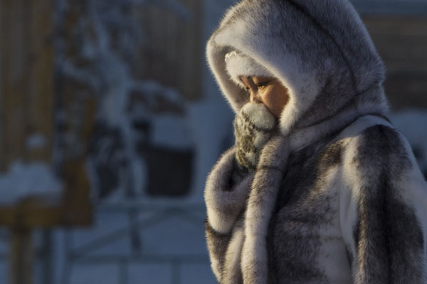 A woman passes by in the village of Tomtor in Oymyakon valley some 700 km from Yakutsk in Russia