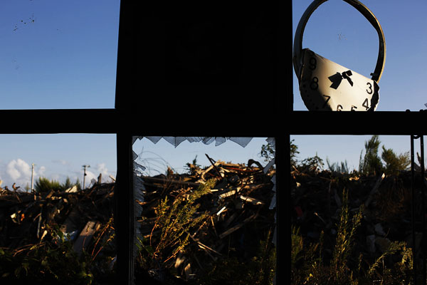 A twisted clock, spider's webs and debris are seen from inside damaged primary school at the tsunami destroyed coastal area of the evacuated town of Namie in Fukushima prefecture only some 6 kilometers from crippled Daiichi power plant
