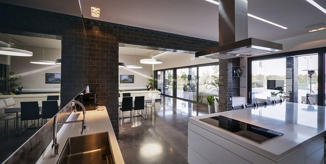 Dark-kitchen-walls-and-white-countertops-create-a-posh-space_1