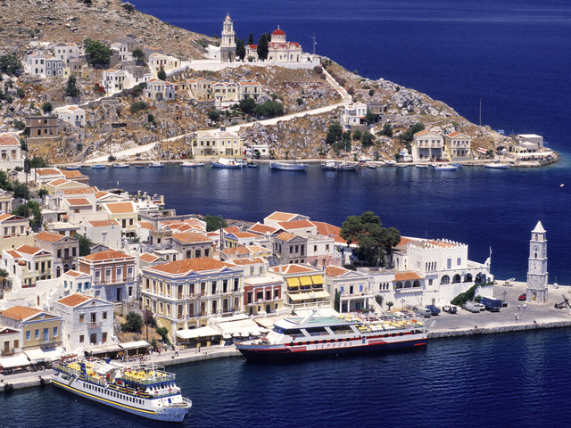 Greece, Dodecanese Islands, Symi Island, Yalos harbour with its 19th century houses